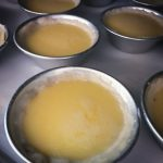 Custard tarts going into the oven